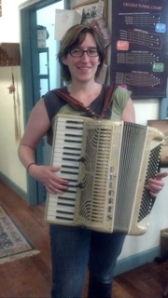 A happy accordionist with a repaired accordion